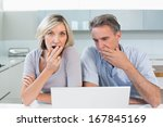 shocked casual couple with... | Shutterstock . vector #167845169