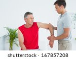male physiotherapist stretching ... | Shutterstock . vector #167857208
