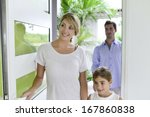 family of three walking in new... | Shutterstock . vector #167860838