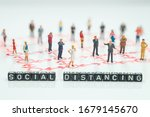 Small photo of Side view of miniature toys standing - social distancing sentence concept.