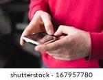 man using a smartphone   Shutterstock . vector #167957780