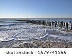 Breakwaters On A Winter Beach...