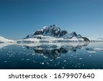 Lemaire strait coast, mountains and icebergs, Antartica.