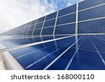 Photovoltaic Cells or Solar Panels with sky - stock photo