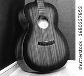 An Old Acoustic Guitar In Black ...