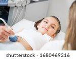 Doctor Ultrasound Examines...