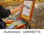 An Artist Draws An Autumn...