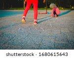 Little Girls Play Hopscotch On...