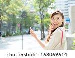 asian business woman walking...   Shutterstock . vector #168069614