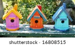 three colorful birdhouses - stock photo