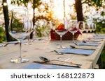 wingalsses on a settle table... | Shutterstock . vector #168122873