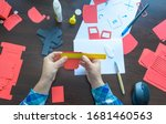 a designer working with paper... | Shutterstock . vector #1681460563