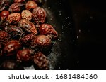 Rose Hip Dried On A Black Table