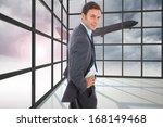 cheerful businessman standing... | Shutterstock . vector #168149468