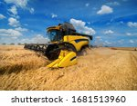 Wheat Field And Combine...