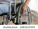 Small photo of Close up of senior handicapped woman sit in wheelchair taken care of in hospital or home, mature disabled old lady grandmother in invalid carriage or wheel chair, elderly disability concept