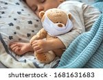 Little Kid Sleeping And Teddy...