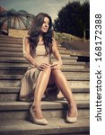 pretty brunette sitting on park ... | Shutterstock . vector #168172388
