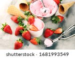 Small photo of Strawberry ice cream scoop with fresh strawberries and icecream cones on a rustic background