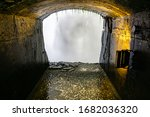 A Tunnel Behind A Falls And...