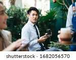Adult Asian Businessman Looking ...
