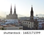 Small photo of Zamora, Michoacan / Mexico - January 21 2020: An early morning view of two of the historic churches of Zamora, Mexico: the cathedral on the left, and the church of San Francisco nearer on the right