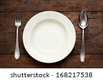 empty plate with spoon and fork ... | Shutterstock . vector #168217538