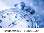 stopwatch on snow in blue toning | Shutterstock . vector #168233654