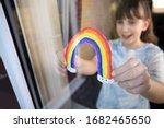 Girl Putting Picture Of Rainbo...