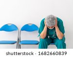 Woman Doctor Is Sitting And Ha...