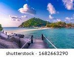 Wooden Bridge To The Island Of...