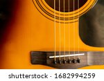 Close Up Of An Acoustic Guitar...