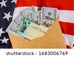 Small photo of Senate stimulus deal includes individual checks virus economic stimulus plan USA dollar cash banknote on American flag Global pandemic Covid 19 lockdown