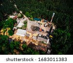 Abandoned ironworks factory with forest