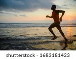 Silhouette Of Young Athletic...