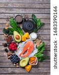 Small photo of Assortment of healthy feel good food, superfood ingredients for stress, anxiety, chronic fatigue, depression relieving, reducing, for relaxation on a kitchen table. Top view flat lay background