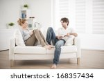 cheerful couple reading books...   Shutterstock . vector #168357434