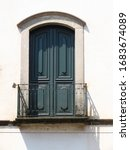 Arched Green Window With...