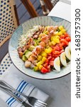 Small photo of Cobb salad. Classic American restaurant or French bistro Cobb salad, made with chopped Bibb or Romain lettuce, heirloom tomatoes, bacon, blue cheese, avocado, hard boiled eggs tossed with olive oil.