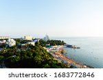 Small photo of The coast of Anapa from a height. View of the calm Black Sea, the stone beach High Coast, the sanatorium, and the old part of the city. Summer at the resort.