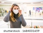 Girl With Medical Mask To...