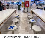 Small photo of Singapore Mar2020 Social distancing rules in practice, alternate seating in local public food courts (kopitiams, restaurants, food outlets), to reduce risk of further transmission; safety measures