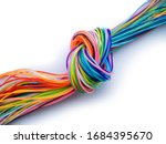 Small photo of multicolored knotted plastic cables als symbol for a bottleneck in data flow or communication isolated on white background