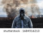 A Man In A Gas Mask In A...