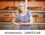 young girl in purple dress with ... | Shutterstock . vector #168452168