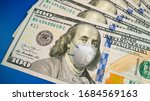 COVID-19 coronavirus in USA, 100 dollar money bill with face mask. Crisis and finance concept - stock photo