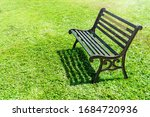 Iron Bench On The Lush Green...