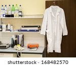 White Robe Hanging On A Door I...