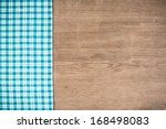 Tablecloth And Wooden Table...