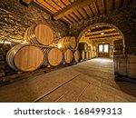 oak wine barrels in winery... | Shutterstock . vector #168499313